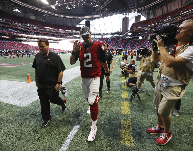 Atlanta Falcons quarterback Matt Ryan (2) leaves the field with an apparent leg injury after Los Angeles Rams defensive tackle Aaron Donald leveled him, causing a fumble that the Rams recovered, during the fourth quarter in an NFL football game Sunday, Oct. 20, 2019, in Atlanta. (Curtis Compton/Atlanta Journal-Constitution via AP)