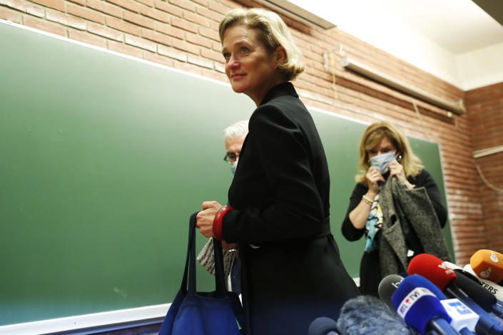 """FILE - In this Monday, Oct. 5, 2020, file photo, Belgium's artist and sculptor Delphine Boel leaves after a press conference in Brussels. Belgium's former King Albert II has been reunited with Delphine Boel, the daughter he fathered out of wedlock over half a century ago, and in a joint statement released by the Royal Palace Tuesday Oct. 27, 2020, they say """"After the tumult, the suffering and the hurt, it is time for forgiveness, healing and reconciliation."""" (AP Photo/Francisco Seco, File)"""