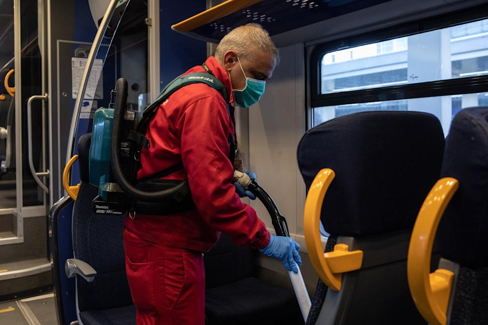 MILAN, ITALY - MARCH 04: A utility service worker, wearing a face mask, deep cleans a Trenord train as a measure to prevent the spread of the SARS-CoV-2 (aka Coronavirus) at Porta Garibaldi train station on March 04, 2020 in Milan, Italy. Across Italy 2.502 people were infected by the novel Coronavirus so far (among these 79 people died - mainly because of a previous and serious clinical picture compromised by the virus-, 2263 people are currently positive and 160 people already recovered). The spread marks Europe's biggest outbreak, prompting Italian Government to issue draconian safety measures. (Photo by Emanuele Cremaschi/Getty Images)