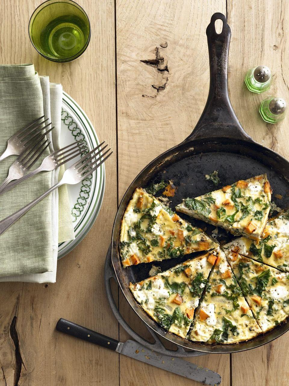 """<p>This easy, eggy dish bakes in the oven for just 10-15 minutes and easily feeds a crowd. What more could you want?</p><p><strong><a href=""""https://www.countryliving.com/food-drinks/recipes/a5502/sweet-potato-kale-frittata-recipe-clx0914/"""" rel=""""nofollow noopener"""" target=""""_blank"""" data-ylk=""""slk:Get the recipe"""" class=""""link rapid-noclick-resp"""">Get the recipe</a>.</strong></p><p><strong><a class=""""link rapid-noclick-resp"""" href=""""https://www.amazon.com/GreaterGoods-Skillet-Pre-Seasoned-handmade-Certified/dp/B07PP9TPRZ/?tag=syn-yahoo-20&ascsubtag=%5Bartid%7C10050.g.2144%5Bsrc%7Cyahoo-us"""" rel=""""nofollow noopener"""" target=""""_blank"""" data-ylk=""""slk:SHOP SKILLETS"""">SHOP SKILLETS</a><br></strong></p>"""