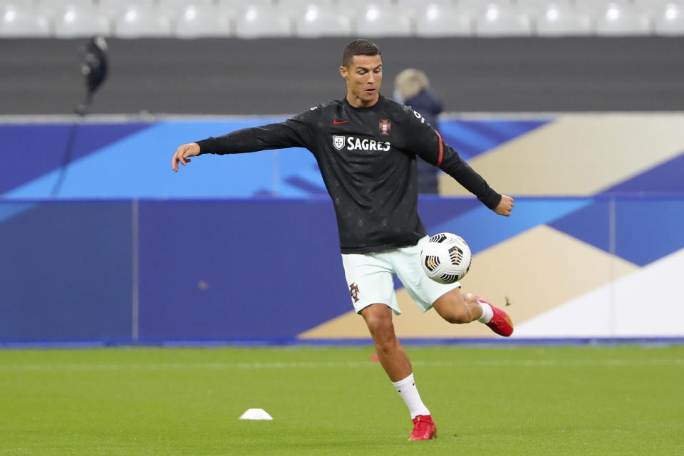 Cristiano Ronaldo kicks a ball during warmups.