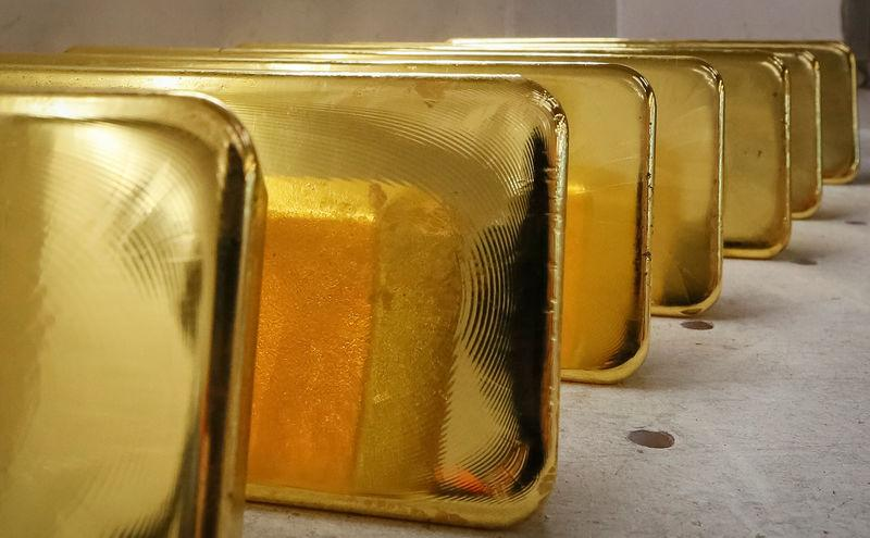 Newly casted ingots of 99.99 percent pure gold are stored after weighing at the Krastsvetmet non-ferrous metals plant in the Siberian city of Krasnoyarsk
