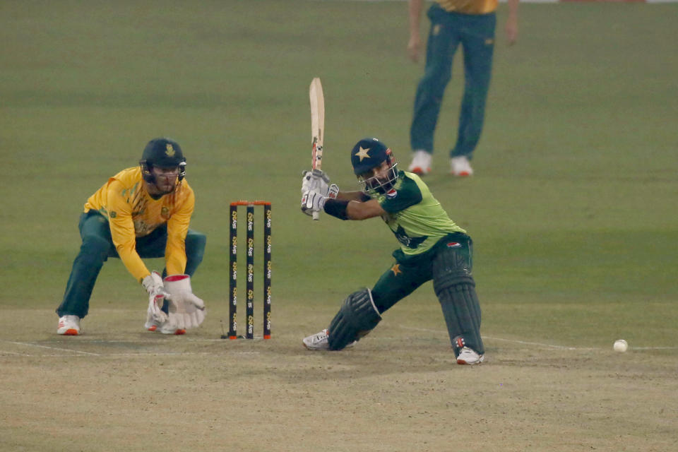 Pakistan's Mohammad Rizwan, right, plays a shot while South Africa Heinrich Klaasen watches during the 2nd Twenty20 cricket match between Pakistan and South Africa at the Gaddafi Stadium, in Lahore, Pakistan, Saturday, Feb. 13, 2021. (AP Photo/K.M. Chaudary)