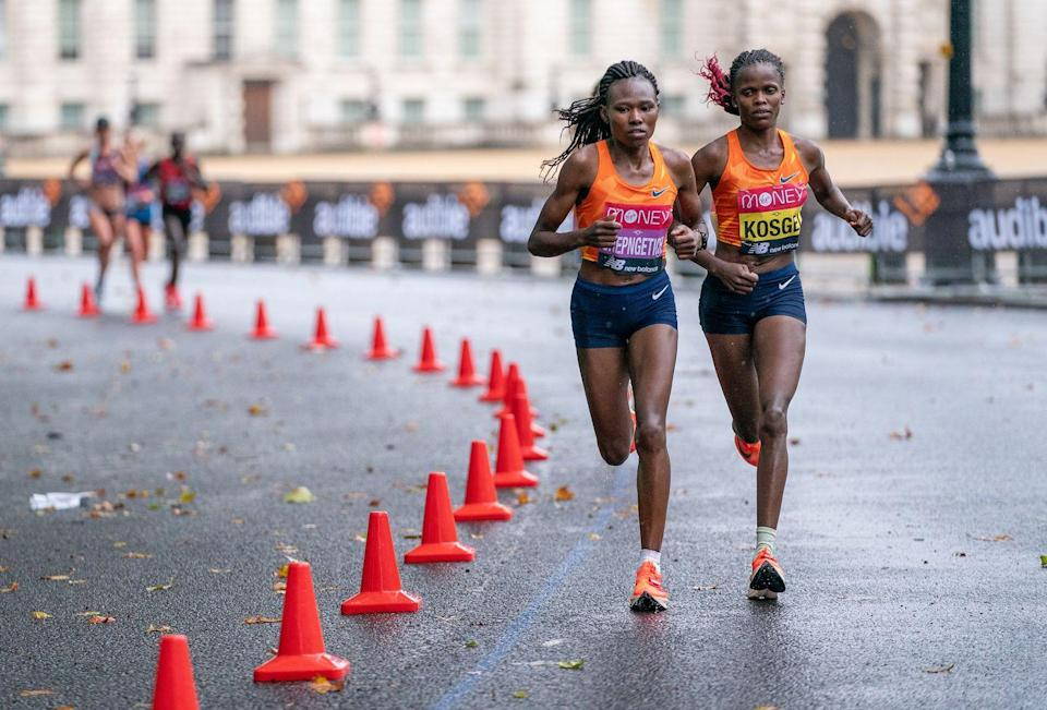 <p>Ruth Chepngetich and Brigid Kosgei running next to each other during the race</p>
