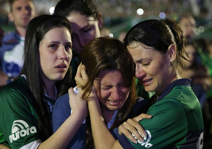 <p>NOV. 30, 2016 — Relatives of Chapecoense soccer players, who died in a plane crash in Colombia, cry during a memorial inside Arena Condado stadium in Chapeco, Brazil. Authorities were working to finish identifying the bodies before repatriating them to Brazil. (AP Photo/Andre Penner) </p>