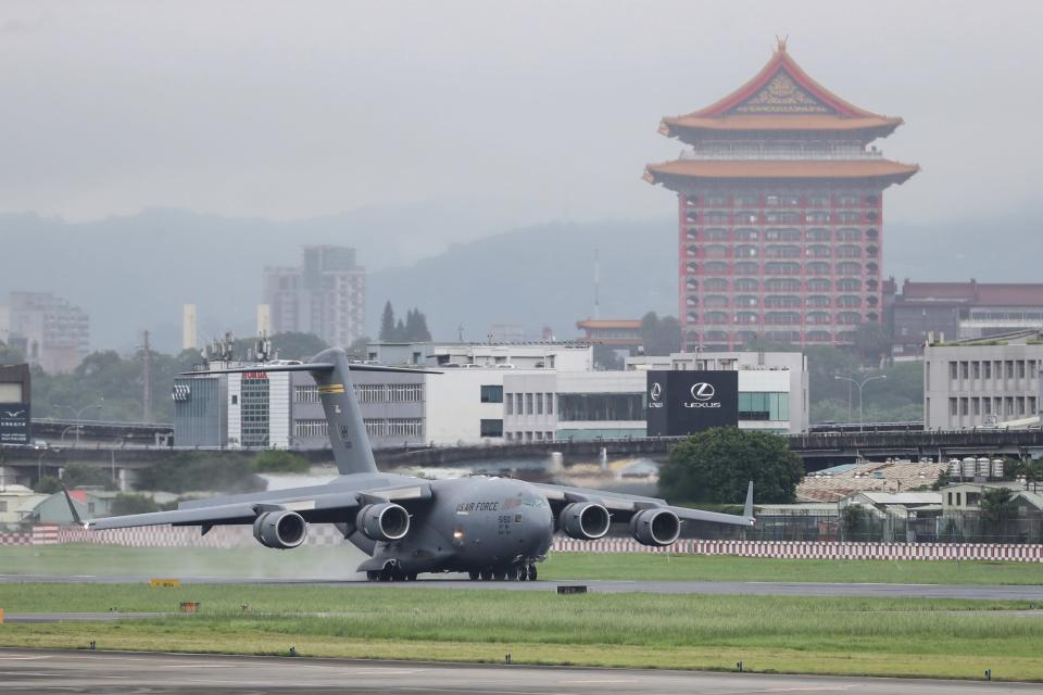 A U.S. military aircraft carrying a group of U.S. senators arrives at the Songshan Airport in Taipei, Taiwan on Sunday, June 6, 2021. The bipartisan group of three U.S. senators arrived in Taiwan to meet with senior government officials and discuss U.S.-Taiwan relations and other issues in a trip that is likely to anger China, which claims Taiwan as its territory and objects to Taiwan being called a country. (Pool Photo via AP)