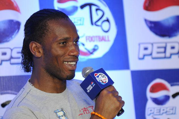International football player from Ivory Coast, Didier Drogba listens to a question during a press conference at a function in New Delhi on June 17, 2012.  Didier Drogba is in the city for the grand finale of the Pepsi T20 football tournament.   AFP PHOTO/ SAJJAD HUSSAIN