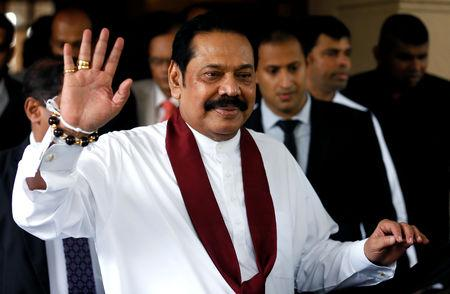 Sri Lanka's newly appointed Prime Minister Mahinda Rajapaksa waves at the staff after participating in the ceremony to assume his duties as the Minister of Finance and Economic Affairs at the Finance Ministry in Colombo, Sri Lanka October 31, 2018. REUTERS/Dinuka Liyanawatte