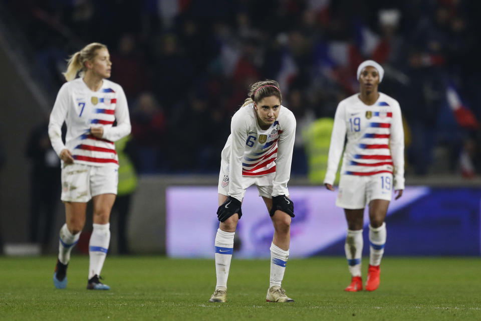 It was a night to forget for Morgan Brian (center), Abby Dahlkemper (left), Crystal Dunn and the U.S. women's national team against France. (Getty)