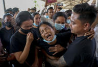 Thida Hnin cries during the funeral of her husband Thet Naing Win at Kyarnikan cemetery in Mandalay, Myanmar, Tuesday, Feb. 23, 2021. Thet Naing Win was shot and killed by Myanmar security forces during an anti-coup protest on Feb. 20. In the month since Feb. 1 coup, the mass protests occurring each day are a sharp reminder of the long and bloody struggle for democracy in a country where the military ruled directly for more than five decades. (AP Photo)