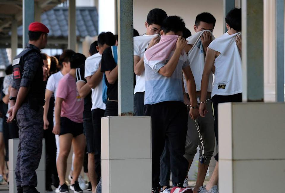 Some of the Chinese nationals who were arrested on suspicion of being involved in an illegal online scam are seen at the Sessions Court in Sepang December 13, 2019. — Bernama pic