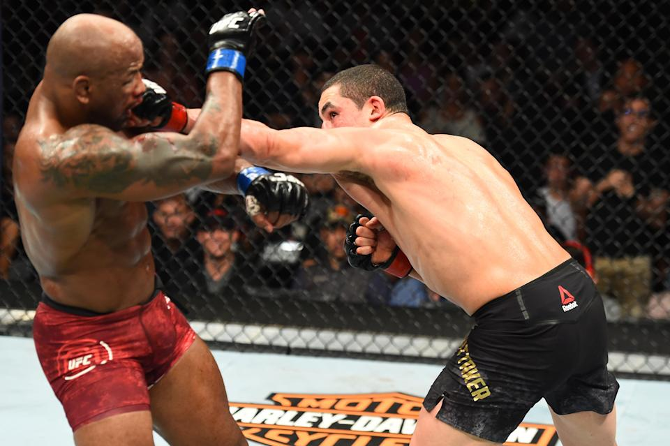 Robert Whittaker punches Yoel Romero in their middleweight fight during the UFC 225 event at the United Center on June 9, 2018 in Chicago, Illinois. (Getty Images)