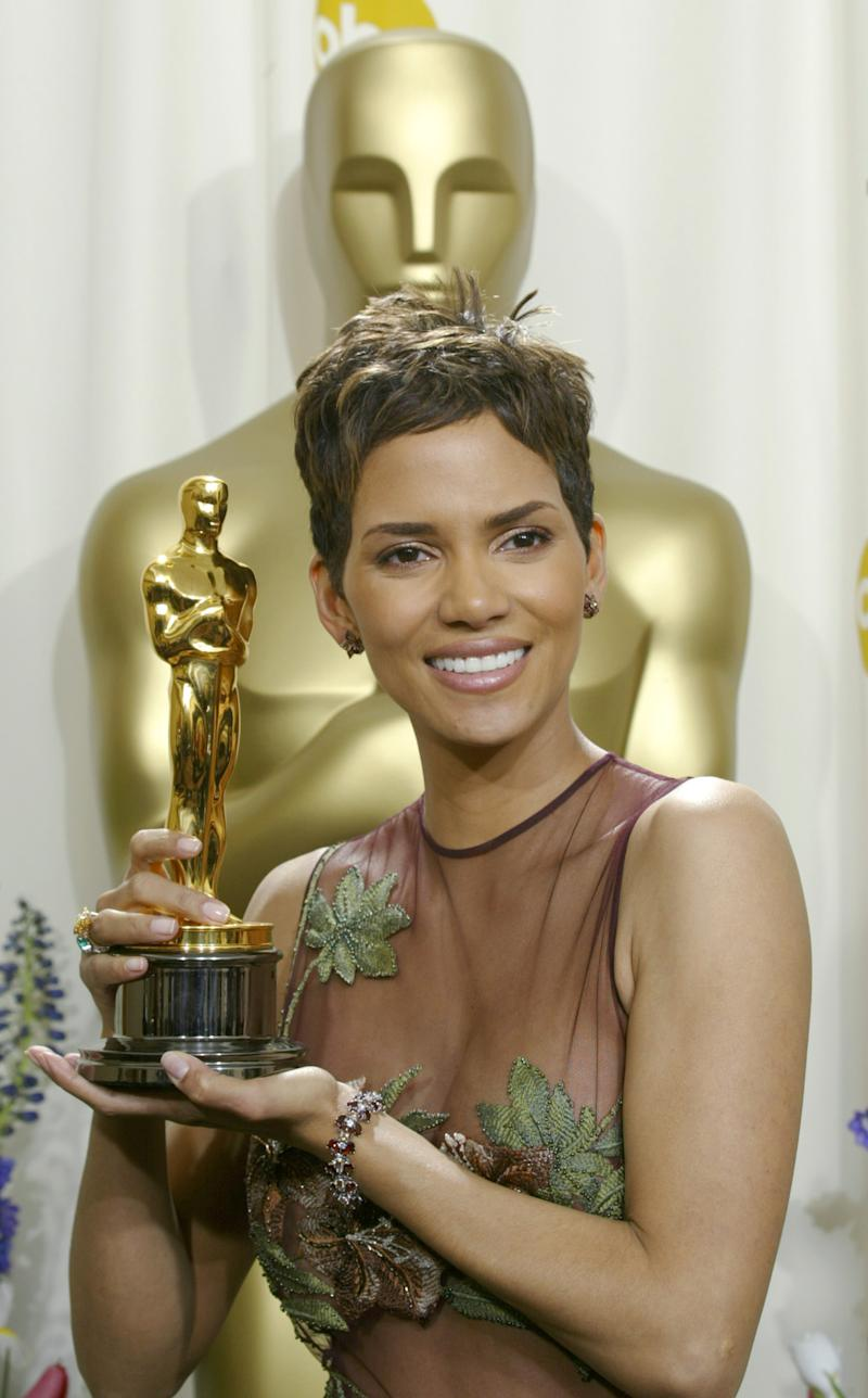"""FILE - In this file photo of March 24, 2002, Halle Berry shows off her Oscar backstage after winning for best actress for her role in """"Monster's Ball"""" during the 74th annual Academy Awards on in Los Angeles. Dorothy Dandridge was the first black woman to be nominated for a Best Actrress Oscar. And almost half a century passed before another black woman, Halle Berry, won the award. (AP Photo/Doug Mills, File)"""