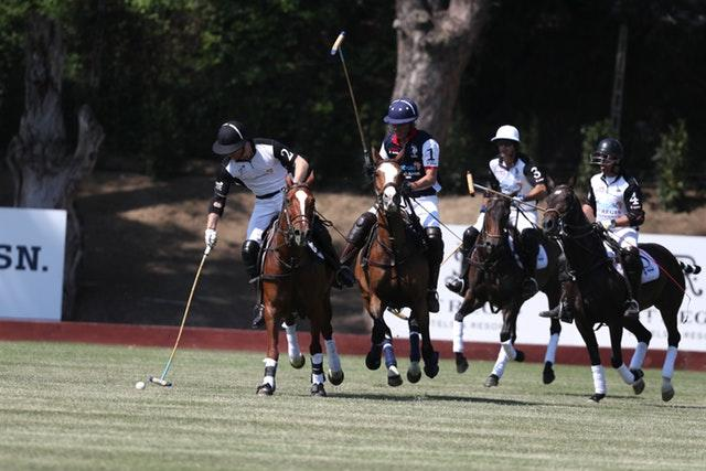 The Duke of Sussex (left) takes part in the match