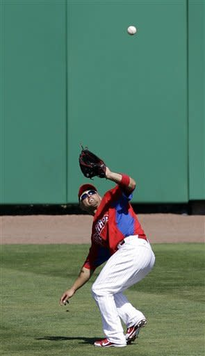 Philadelphia Phillies center fielder Shane Victorino shields his eyes from the sun as he fields Pittsburgh Pirates' Josh Harrison's fifth-inning flyout in the Phillies' 5-4 victory over the Pirates in their spring training baseball game at Brighthouse Field in Clearwater, Fla., Thursday, March 8, 2012. (AP Photo/Kathy Willens)