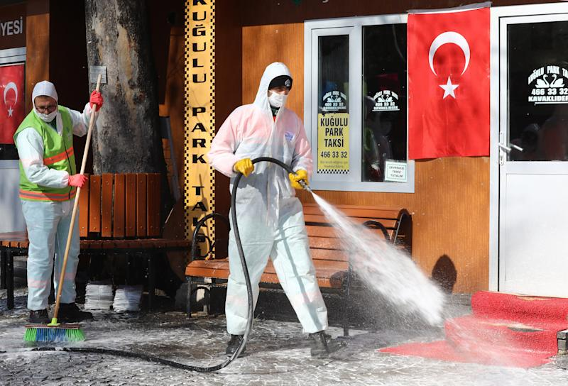 Disinfection works are being carried out by officials, wearing protective suits, at Kugulu Park as part of precautions against the coronavirus (COVID-19), on March 17, 2020 in Ankara. - Many public places in Turkey's capital Ankara are being disinfected against the spread of the deadly coronavirus. (Photo by Adem ALTAN / AFP) (Photo by ADEM ALTAN/AFP via Getty Images)