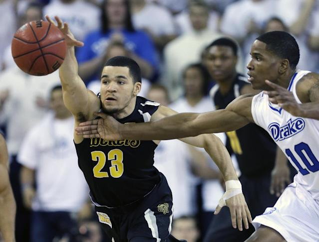 Wichita State guard Fred VanVleet, left, steals the ball from Drake forward Trevor Berkeley during the first half of an NCAA college basketball game, Saturday, Jan. 25, 2014, in Des Moines, Iowa. (AP Photo/Charlie Neibergall)
