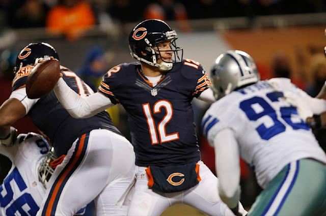 Chicago Bears quarterback Josh McCown (12) fires a pass against the Dallas Cowboysduring the second half of an NFL football game, Monday, Dec. 9, 2013, in Chicago. (AP Photo/Charles Rex Arbogast)