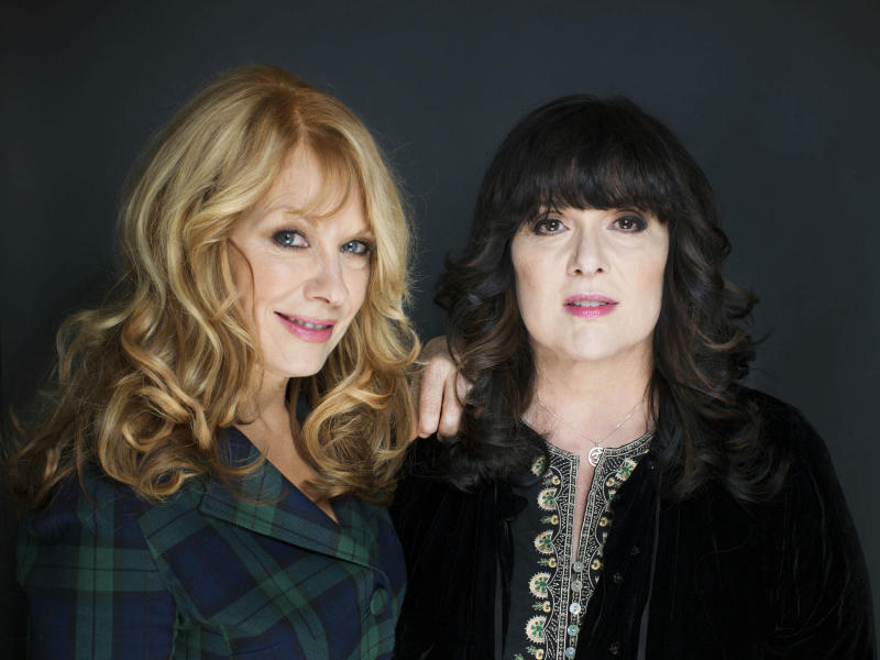 "This Oct. 1, 2012 file photo shows sisters Nancy, left, and Ann Wilson from Heart in New York. The eclectic group of rockers Rush and Heart, rappers Public Enemy, songwriter Randy Newman, ""Queen of Disco"" Donna Summer and bluesman Albert King will be inducted into the Rock and Roll Hall of Fame April 18, 2013, in Los Angeles. (Photo by Victoria Will/Invision/AP)"