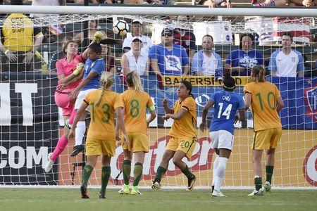 Aug 3, 2017; Carson, CA, USA; Australia goalkeeper Mackenzie Arnold (1) blocks the ball in front of Brazil midfielder Debinha (9) during the second half at StubHub Center. Mandatory Credit: Kelvin Kuo-USA TODAY Sports