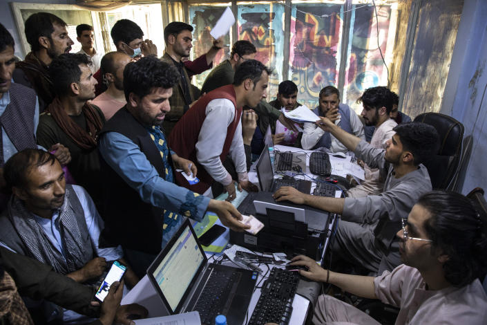 Afghan Special Immigrant Visa (SIV) applicants crowd into the Herat Kabul Internet cafe to apply for the SIV program on August 8, 2021 in Kabul, Afghanistan. Many Afghans are in desperate need of assistance completing the forms and obtaining required human resources letters, a particular challenge for those whose US government work ended years ago. (Paula Bronstein/Getty Images)