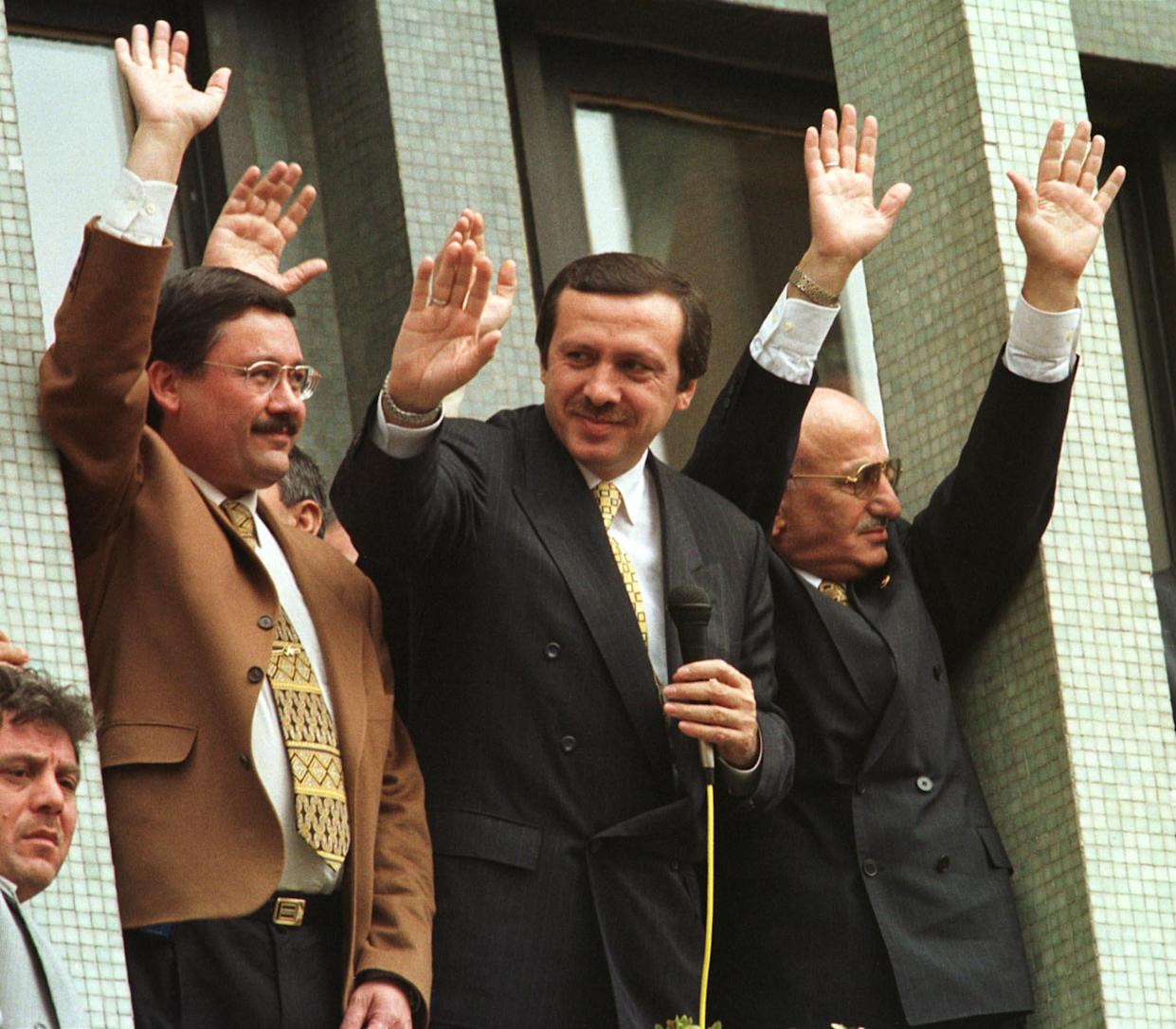 Then-mayor of Istanbul Recep Tayyip Erdogan, center, waves to his supporters in 1998. (Photo: Murad Sezer/AP)
