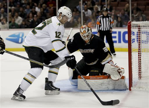 Dallas Stars' Alex Chiasson, left, looks to shoot against Anaheim Ducks goalie Viktor Fasth, of Sweden, during the first period of an NHL hockey game in Anaheim, Calif., Wednesday, April 3, 2013. (AP Photo/Jae C. Hong)