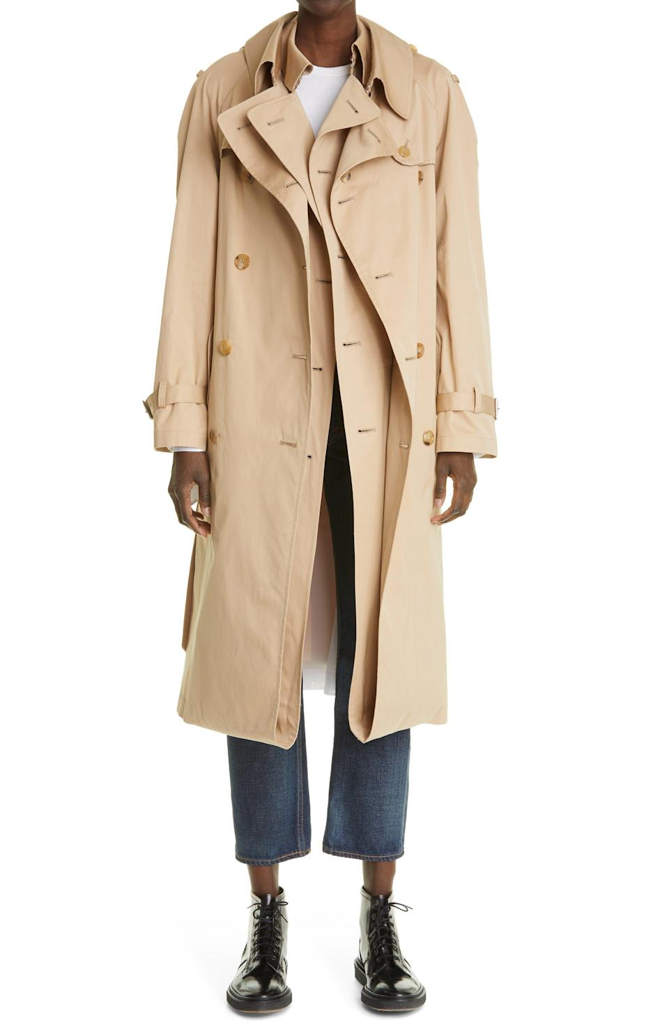 """<p><strong>Junya Watanabe</strong></p><p>nordstrom.com</p><p><strong>$1084.00</strong></p><p><a href=""""https://go.redirectingat.com?id=74968X1596630&url=https%3A%2F%2Fwww.nordstrom.com%2Fs%2Fjunya-watanabe-double-layer-trench-coat%2F5872224&sref=https%3A%2F%2Fwww.elle.com%2Ffashion%2Fshopping%2Fg37093153%2Fdesigner-deals-nordstroms-anniversary-sale-2021%2F"""" rel=""""nofollow noopener"""" target=""""_blank"""" data-ylk=""""slk:Shop Now"""" class=""""link rapid-noclick-resp"""">Shop Now</a></p><p><strong><del>$2,710 </del>$1,084 (60% off)</strong></p>"""