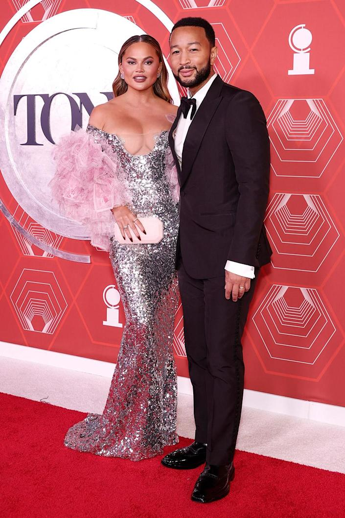 <p>Chrissy Teigen looks pretty in pink (and silver!) on the red carpet with her husband, John Legend, who performed with the cast of <em>Ain't Too Proud the Musical</em>.</p>