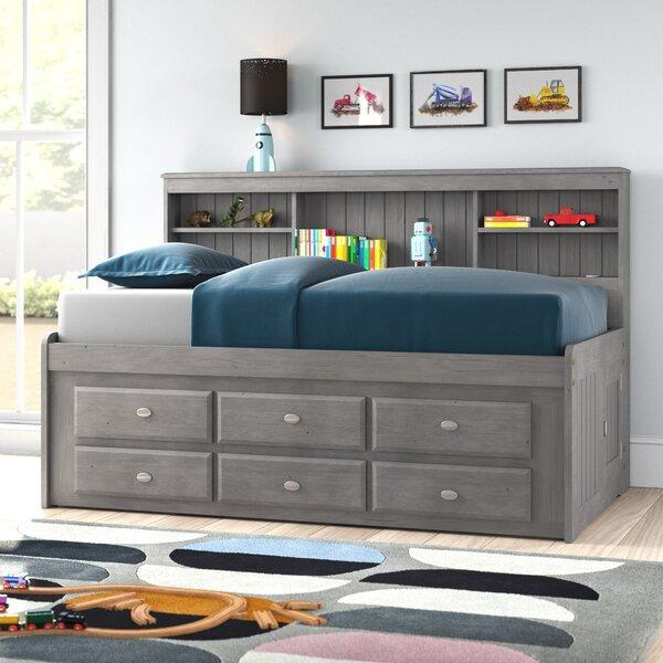"<p>This captain's bed does double duty as a storage bed <em>and</em> a bookcase. The shelves in the bookcase are adjustable so you can place them to suit your needs. The bed frame itself is made with solid wood, and the interior has slats. No box spring mattress is required. </p> <p><strong>Sizes available:</strong> Twin and full</p> <p><strong>Stars:</strong> 4.3 out of 5</p> <p><strong>Customer Review:</strong> ""I was looking for a twin bed frame that would allow me to condense my current bedroom down to the essentials. I'm planning on getting rid of my dresser and using the hatch space for out-of-season clothes storage. The assembly only took about two hours to do myself. The directions were good and all the necessary parts came with the materials."" —<em>Dominique</em></p> $870, Wayfair. <a href=""https://www.wayfair.com/Harriet-Bee--Gilbertson-Bed-with-Bookcase-and-6-Drawers-X111384072-L1074-K~W000273961.html"" rel=""nofollow noopener"" target=""_blank"" data-ylk=""slk:Get it now!"" class=""link rapid-noclick-resp"">Get it now!</a>"