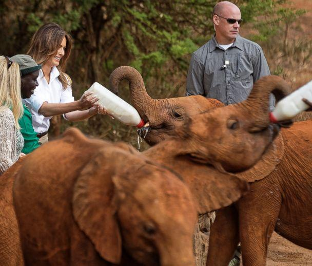 PHOTO: First lady Melania Trump feeds a baby elephant milk at the David Sheldrick Wildlife Trust Elephant Orphanage in Nairobi, Kenya, Oct. 5, 2018. (Ben Curtis/Pool via Reuters)