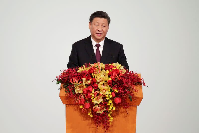 FILE PHOTO:  Chinese President Xi Jinping speaks at a ceremony on the 20th anniversary of the former Portuguese colony's return to China in Macau