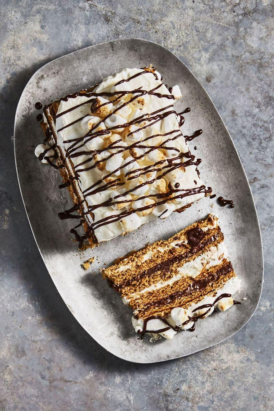 """<p>Bring the campfire favorite inside! This no-bake """"cake"""" is stacked with layers of grahams, chocolate, and marshmallow cream.</p><p><em><a href=""""https://www.goodhousekeeping.com/food-recipes/dessert/a45720/smores-icebox-cake-recipe/"""" rel=""""nofollow noopener"""" target=""""_blank"""" data-ylk=""""slk:Get the recipe for S'mores Icebox Cake »"""" class=""""link rapid-noclick-resp"""">Get the recipe for S'mores Icebox Cake »</a></em> </p>"""
