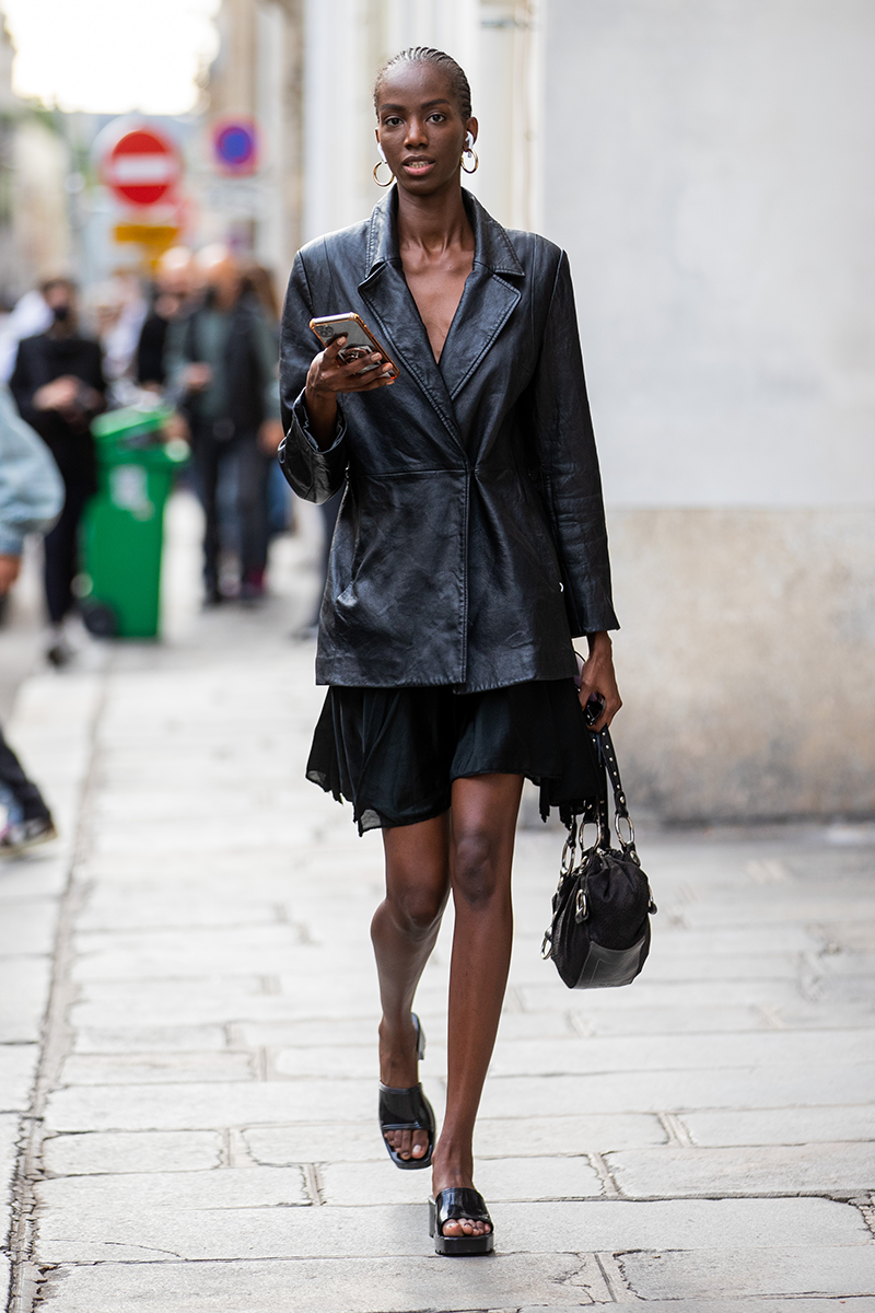 <p>Give your go-to mini and midi dresses an office spin by layering under structured outerwear, like this leather blazer, and slipping on a pair of matching mules.</p>