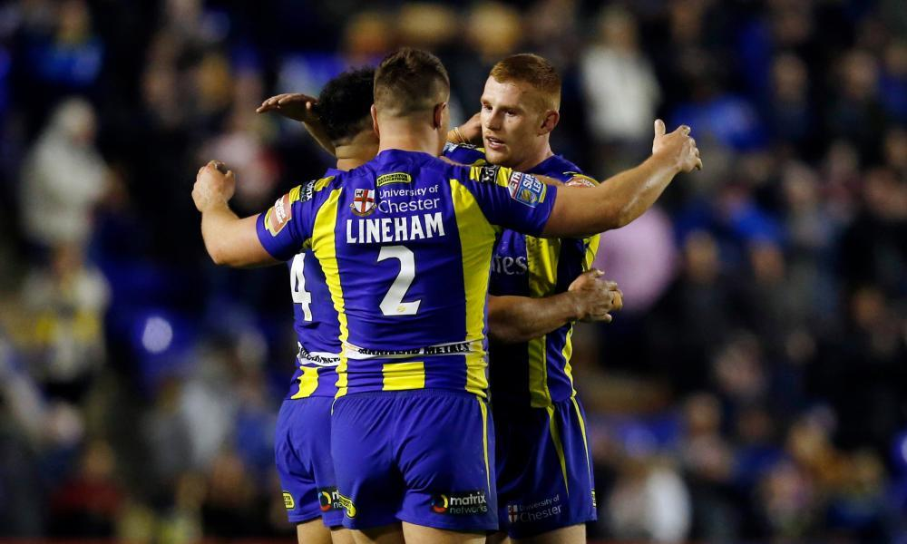 Warrington Wolves celebrate after breaking their seasonal duck against Leeds Rhinos.