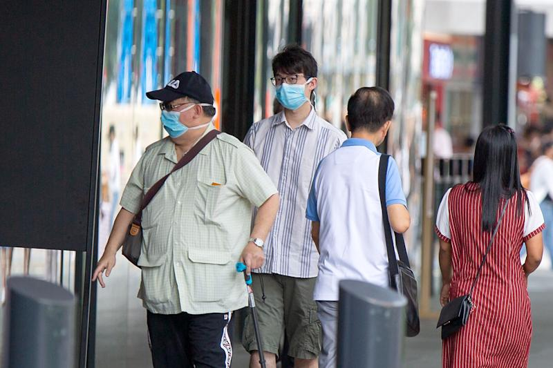 Two men seen wearing face masks outside the Funan Mall on Monday (27 January). (PHOTO: Dhany Osman / Yahoo News Singapore)