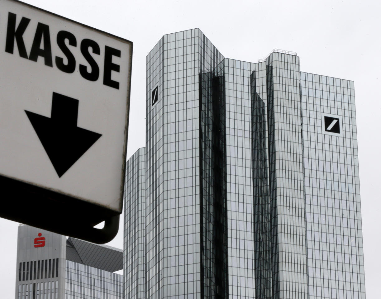 A sign reading cash point stands next to the Deutsche Bank headquarters in Frankfurt, Germany, Friday, Sept. 30, 2016. Worries over the financial health of Deutsche Bank returned to the fore Friday, sending the company's share price into a tailspin and to a record low. (AP Photo/Michael Probst)