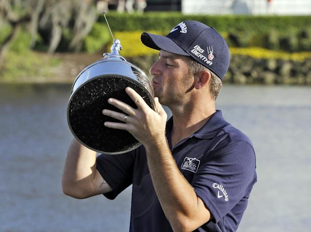 Matt Every kisses the trophy after winning the Arnold Palmer Invitational golf tournament at Bay Hill, Sunday, March 23, 2014, in Orlando, Fla. (AP Photo/Chris O'Meara)