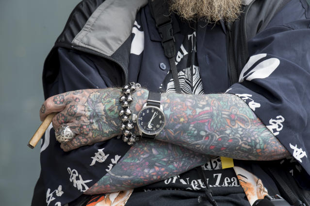 <p>A man sits with his cigar at the London Tattoo convention at Tobacco Dock on Sept. 23, 2017 in London, England. (Photo: James D. Morgan/Getty Images) </p>