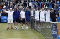 (left to right) Boris Johnson, Jonathan Ross, Jimmy Carr, Andy Murray, Ross Hutchins, Tim Henman, Richard Branson, Eddie Redmayne, and Michael McIntyre take part in a celebrity tennis match in aid of the Royal Marsden Hospital at The Queen's Club, London.
