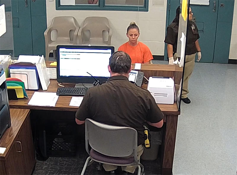 This photo from video released Thursday, Sept. 13, 2018, by the Kaufman County Sheriff's Office in Kaufman, Texas, shows Dallas police Officer Amber Guyger getting booked after turning herself in Sunday, Sept. 9 following the fatal shooting of Botham Jean in his own apartment. Guyger was arrested manslaughter and has since been released on bond. (Kaufman County Sheriff's Office Jail via AP)