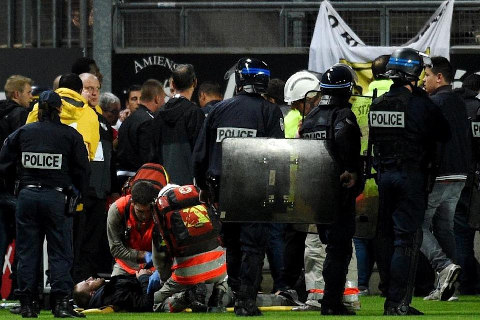 The Lille-Amiens match was suspended in the 16th minute as Red Cross and emergency workers rushed to help the injured fans at the Licorne stadium in the northern French city of Amiens (AFP Photo/FRANCOIS LO PRESTI)
