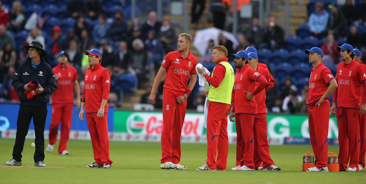 England bowler Stuart Broad (centre) watches the TV screen to see if his foot was over the line as he bowled New Zealand batsman Kane Williamson ou during the ICC Champions Trophy match at the SWALEC Stadium, Cardiff.