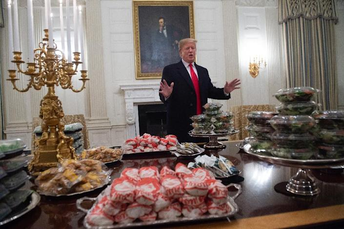 """In January, Donald Trump welcomed college football champions the Clemson Tigers with what he called an """"all American"""" feast of burgers and pizzas (AFP Photo/SAUL LOEB)"""