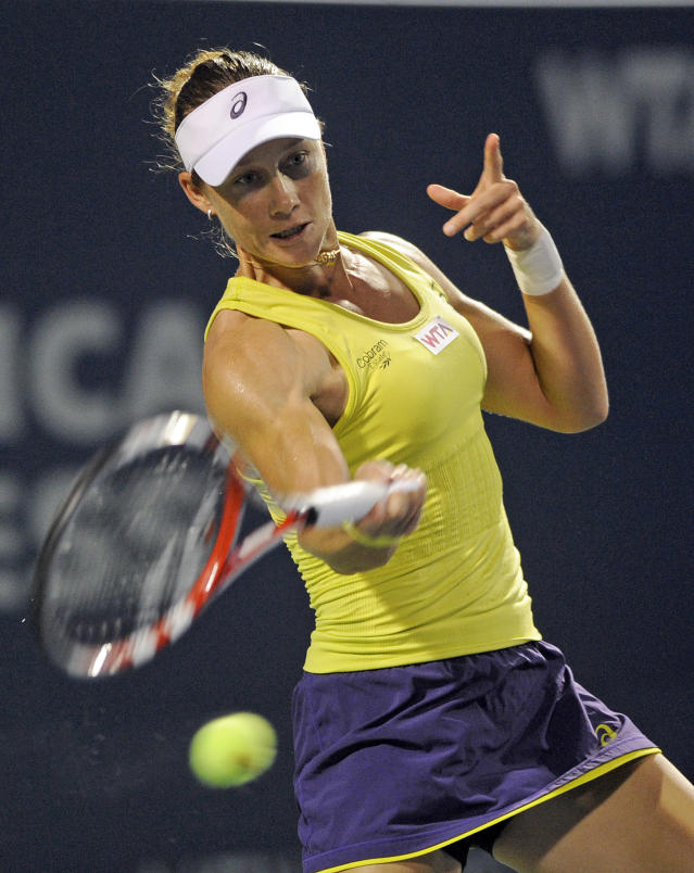 Samantha Stosur, of Australia, hits a forehand during a quarterfinal match against Kirsten Flipkens, of Belgium, at the New Haven Open tennis tournament in New Haven, Conn., on Thursday, Aug. 21, 2014. (AP Photo/Fred Beckham)