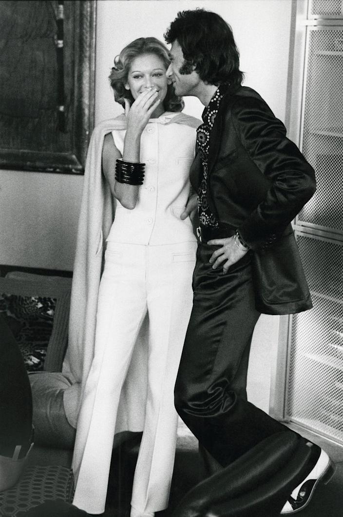 <p>Singer Johnny Hallyday mingles with guests while hosting a party in his Paris apartment in 1972, which he shared with his girlfriend, Sylvie Vartan. </p>