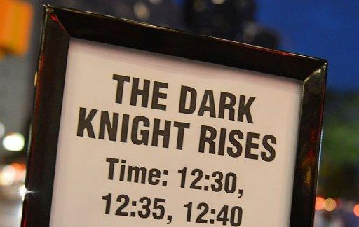 "A signboard outside a Midnight Premiere showing of the ""The Dark Knight Rises"" on Thursday. At least 10 people were killed and several wounded early Friday when two gunmen wearing gas masks and body armor opened fire at a crowded cinema premiere in the US city of Aurora, media reported"