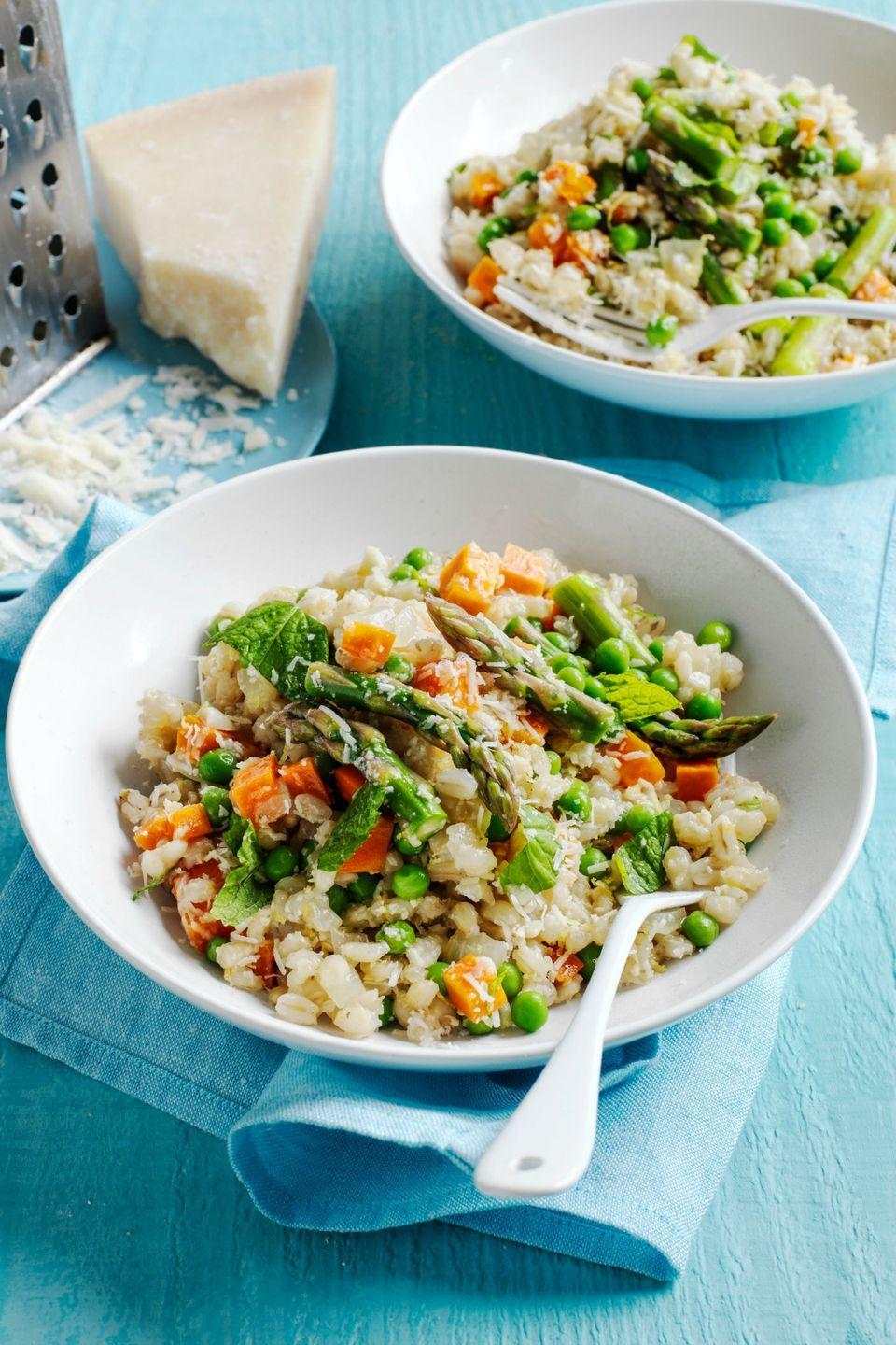 """<p>This heart-healthy recipe uses barley instead of a white grain to make risotto. Then add carrots, asparagus, and peas to make it extra filling. </p><p><a href=""""https://www.womansday.com/food-recipes/food-drinks/recipes/a54435/barley-risotto-recipe/"""" rel=""""nofollow noopener"""" target=""""_blank"""" data-ylk=""""slk:Get the Barley Risotto recipe."""" class=""""link rapid-noclick-resp""""><em>Get the Barley Risotto recipe.</em></a></p>"""