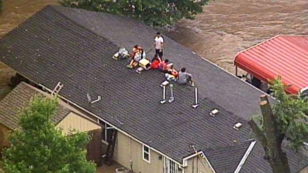 PHOTO: This aerial photo from a video by KCTV5 shows a family forced onto the roof of a home in Overland Park, Kan., Aug. 22, 2017, after heavy rains caused flash flooding in the Kansas City area. Flash flood warnings have been issued across the area. (KCTV5 via AP)