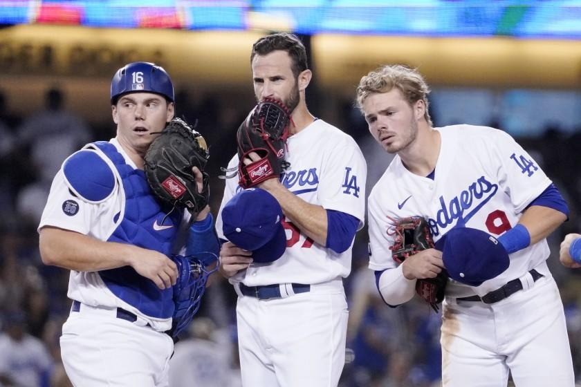 Los Angeles Dodgers catcher Will Smith, left, Los Angeles Dodgers' Jake Reed, center, and shortstop baseman Gavin Lux.